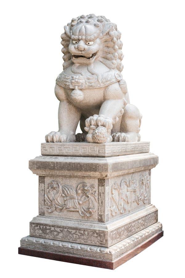 Китайский камень льва изолированный на белой предпосылке стоковая фотография