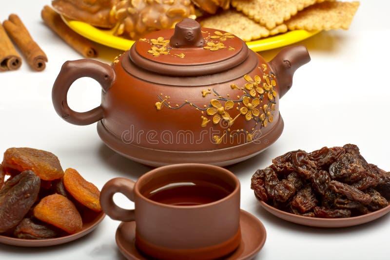 Китайский чай, и высушенные плодоовощи стоковое фото rf