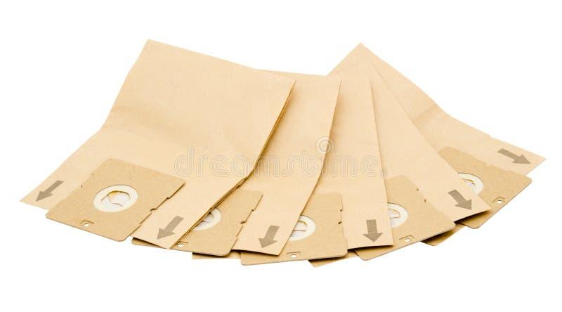 кладет более чистый вакуум в мешки бумаги пыли стоковое изображение rf