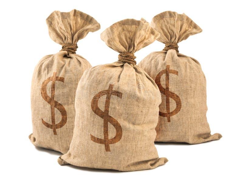 кладет деньги в мешки стоковые изображения rf