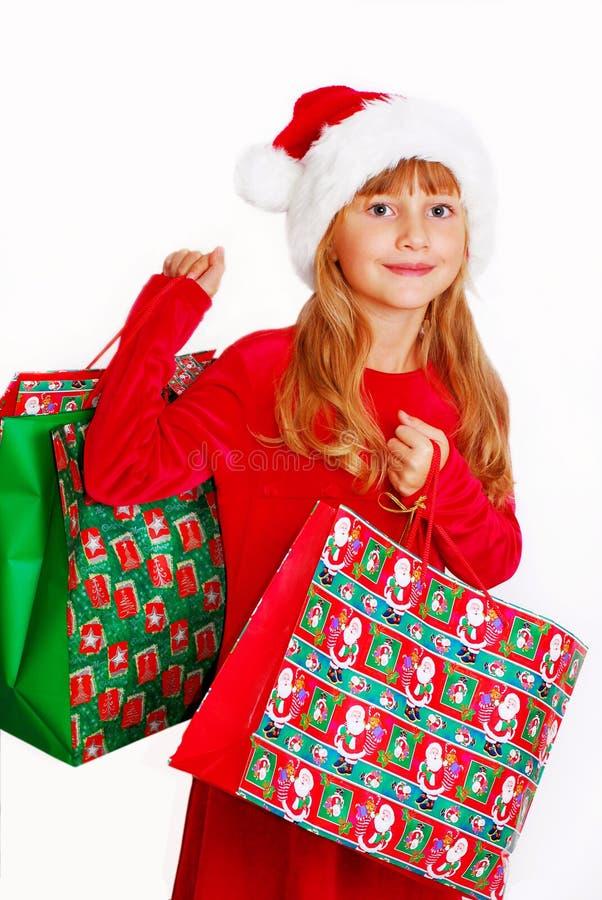 кладет детенышей в мешки santa девушки подарка ткани стоковое изображение rf