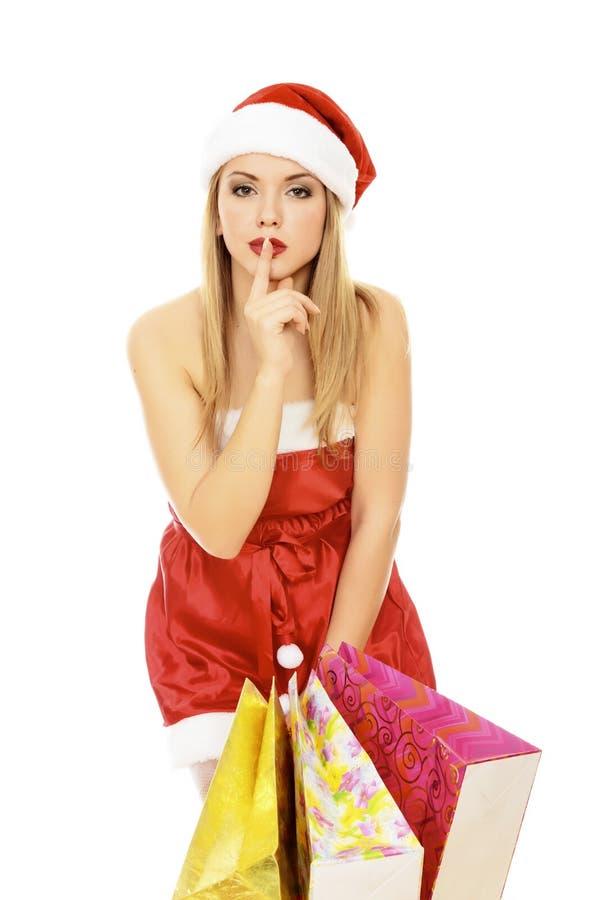 кладет женскую покупку в мешки santa стоковая фотография rf