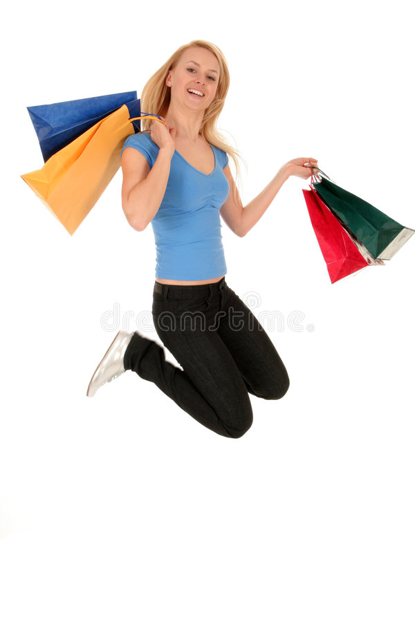 кладет скача женщину в мешки покупкы стоковые фото