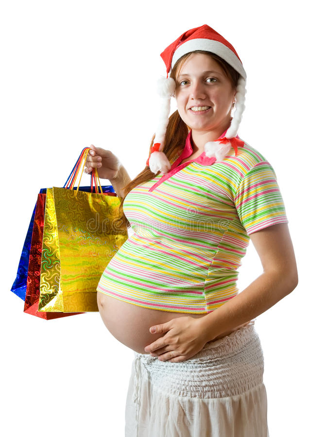 кладет супоросую женщину в мешки покупкы стоковые изображения rf