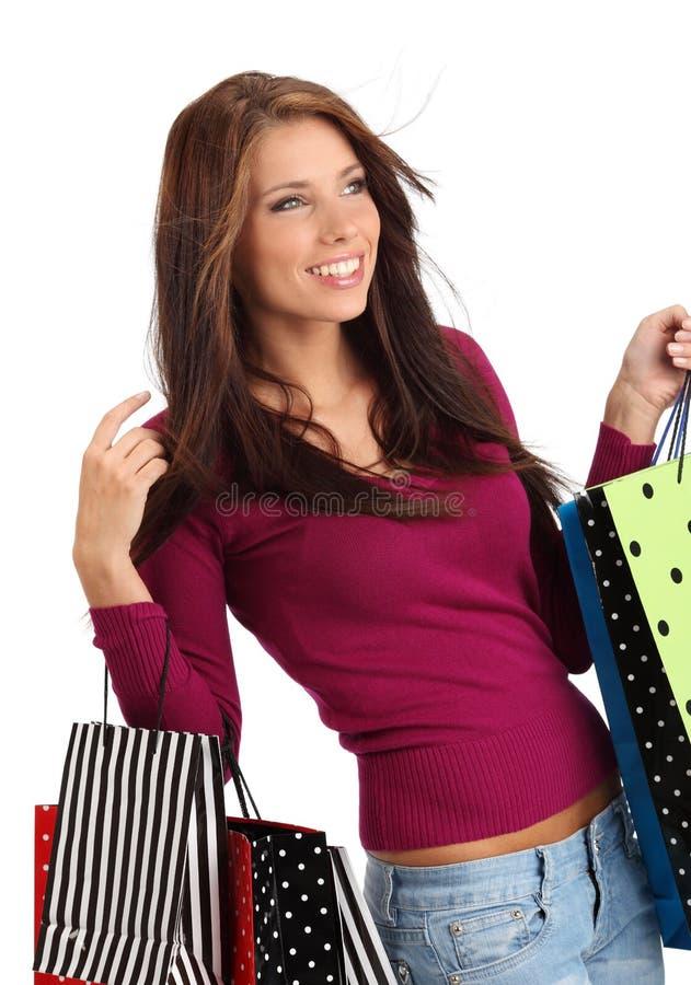 кладет цветастую женщину в мешки покупкы стоковая фотография