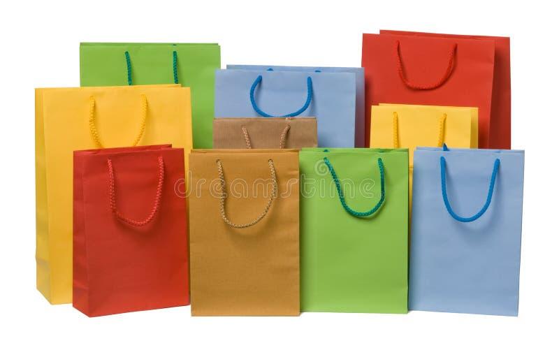 кладет цветастую покупку в мешки стоковое фото rf