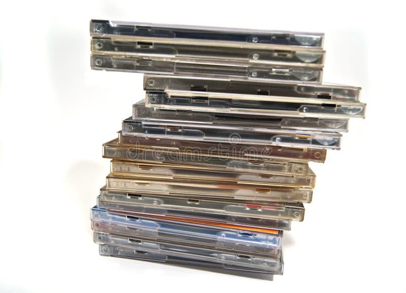 кладет cd dvd в коробку много стоковое изображение rf