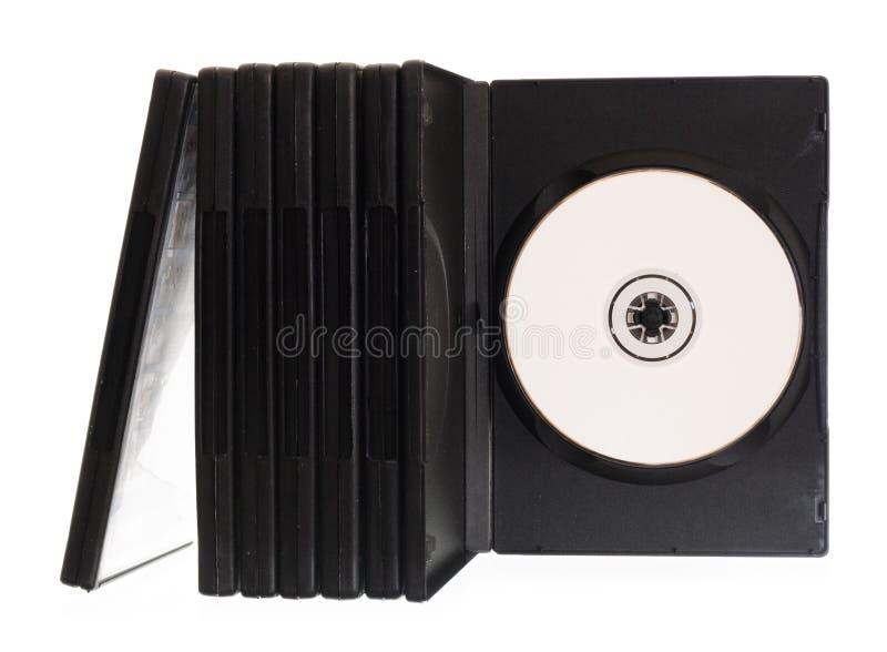 кладет dvd в коробку стоковая фотография