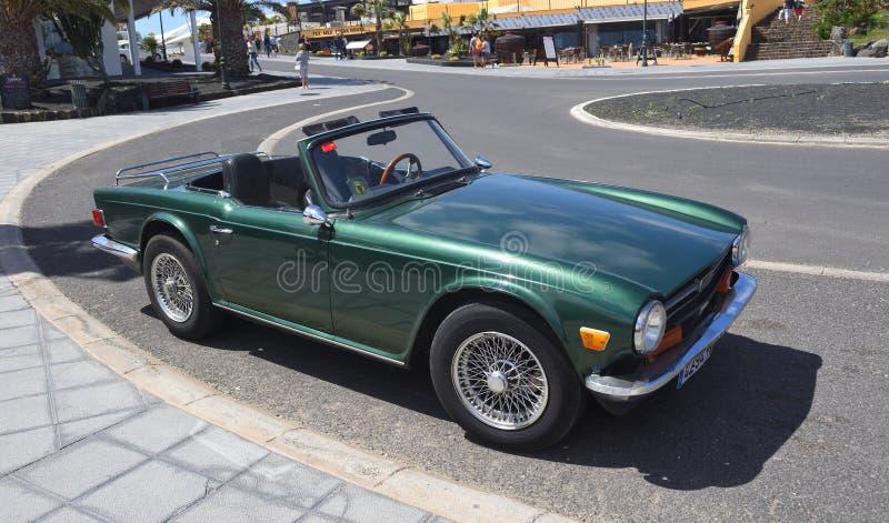 Классический зеленый автомобиль триумфа TR6 стоковые фото