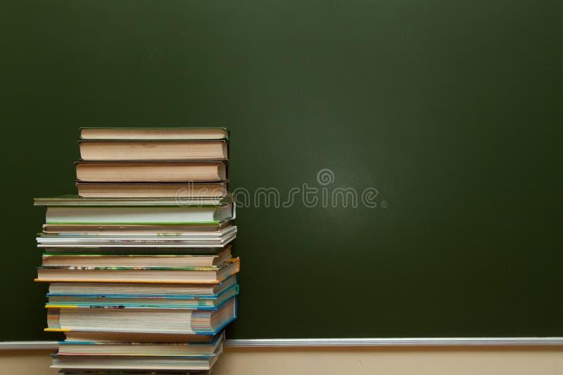 Классн классный и учебники стоковая фотография
