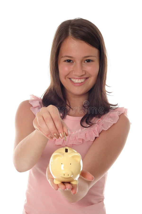 класть девушки монетки банка piggy стоковые фотографии rf