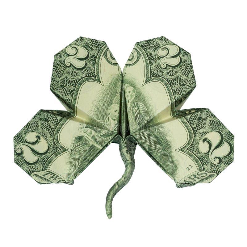 КЛЕВЕР сложенный с реальной долларовой банкнотой 2 стоковая фотография