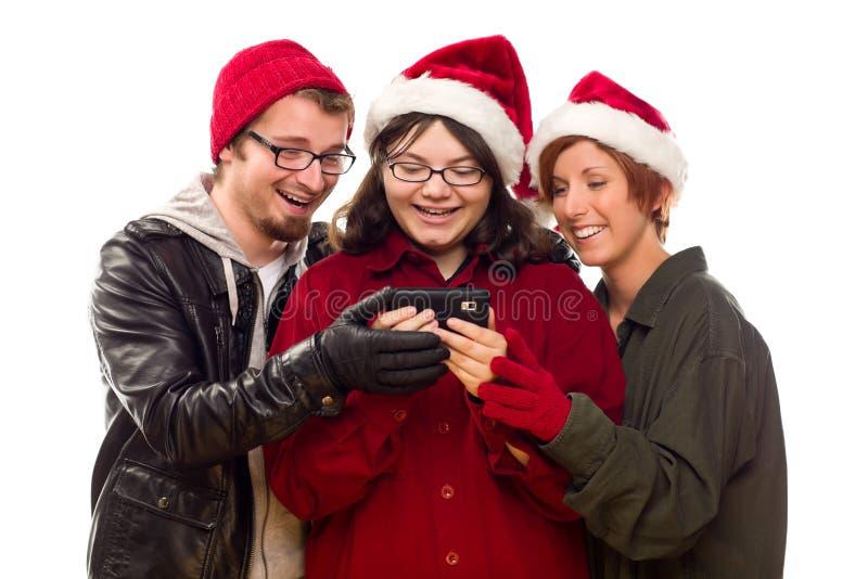 клетка наслаждаясь друзьями знонит по телефону 3 совместно стоковая фотография