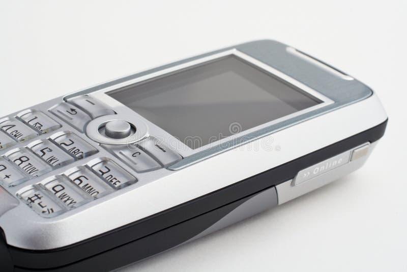 клетчатый мобильный телефон стоковое фото