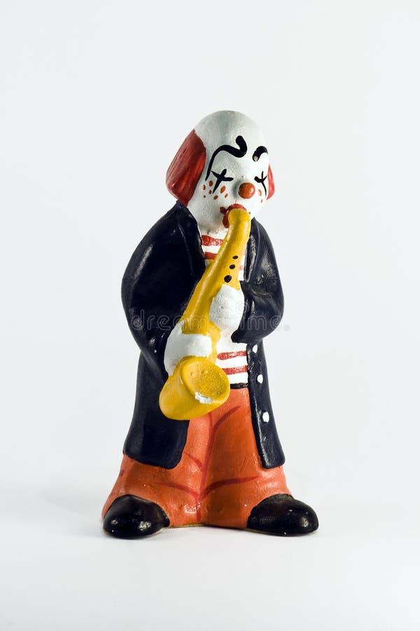 клоун играя trumpet стоковое фото