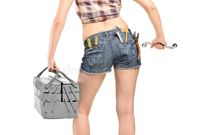 ключ работника инструмента удерживания коробки женский стоковые изображения rf