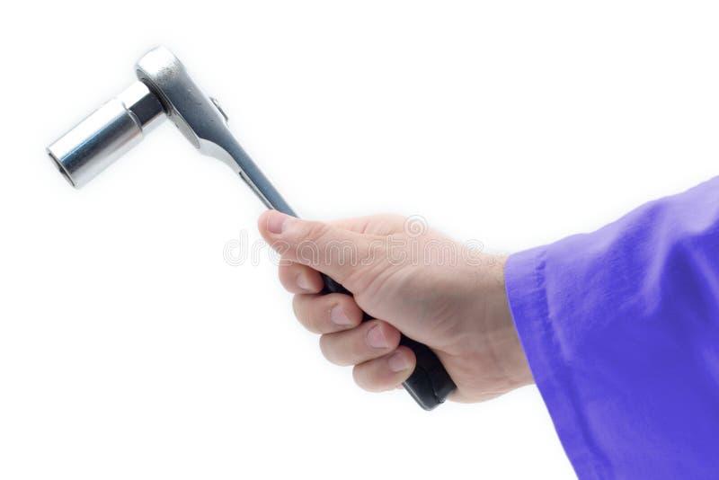 Download ключ удерживания руки стоковое фото. изображение насчитывающей аппаратура - 489582