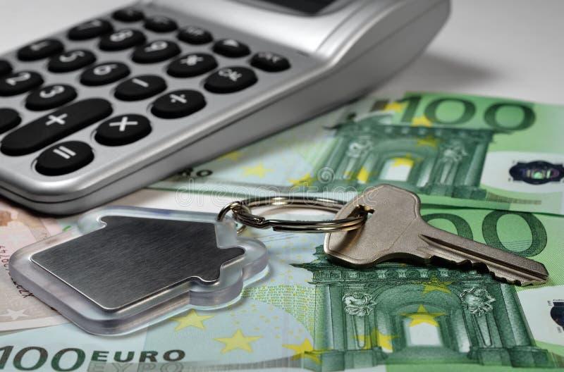 Ключ чалькулятора, денег и дома стоковое изображение rf