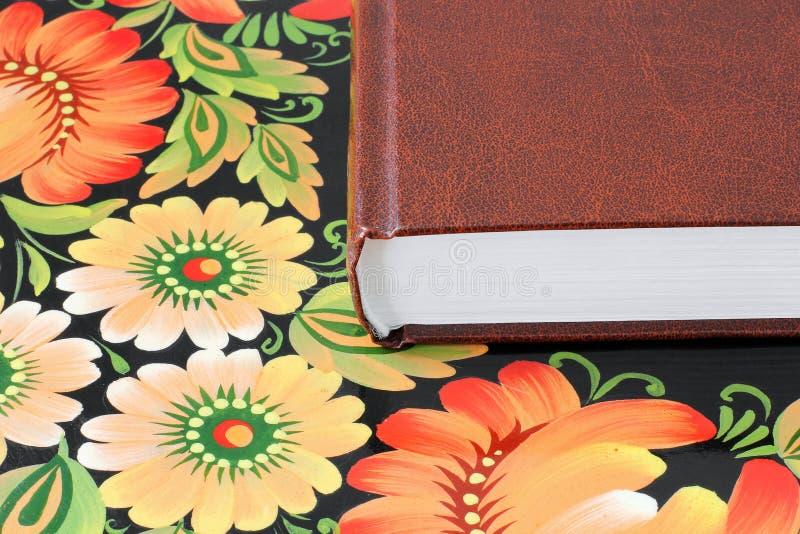 Книга на конце таблицы вверх стоковое изображение