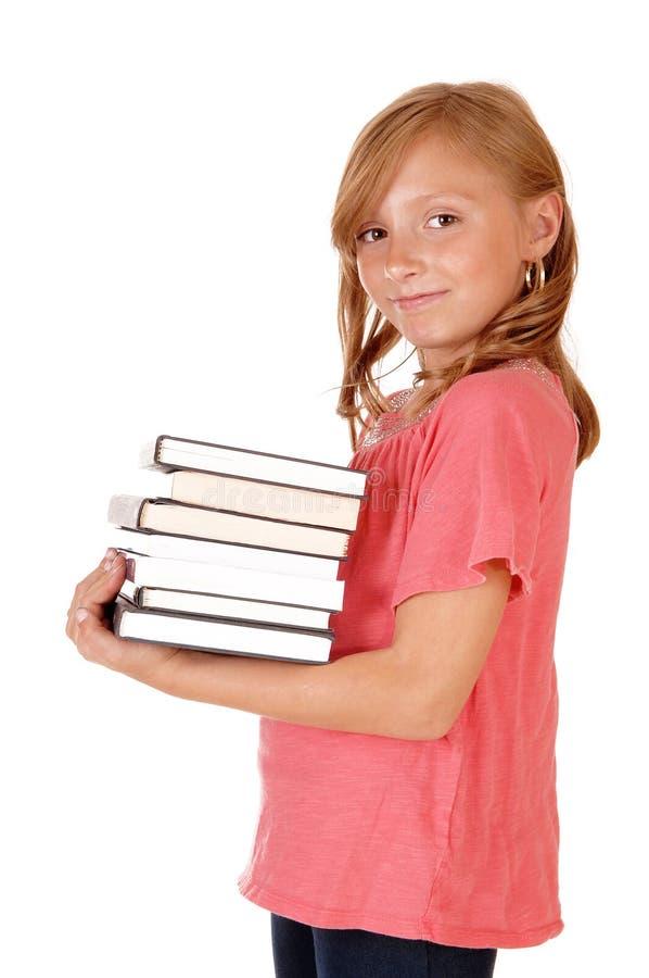 Книги маленькой девочки заботя стоковое фото