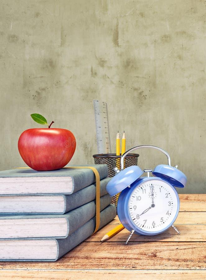 Книги с красными часами яблока и сини стоковое фото rf