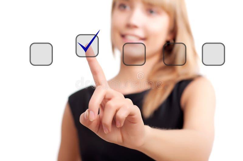 кнопка нажимая женщину касания стоковое фото