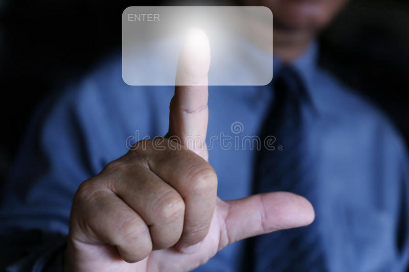 Кнопка щелчка пальца пользы бизнесмена воздух стоковые фото