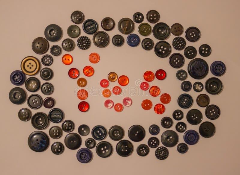 Кнопки для одежд стоковые изображения