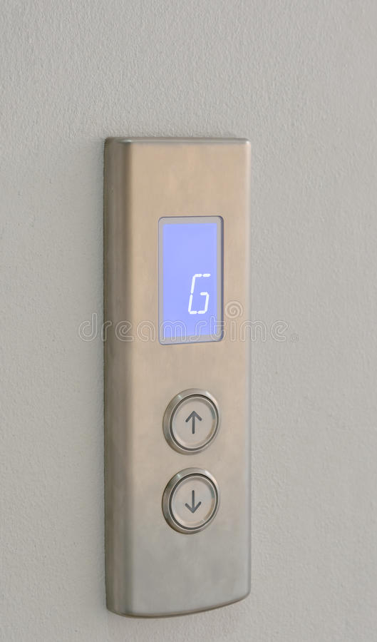 Кнопки лифта вверх и вниз направления с цифровым дисплеем стоковая фотография