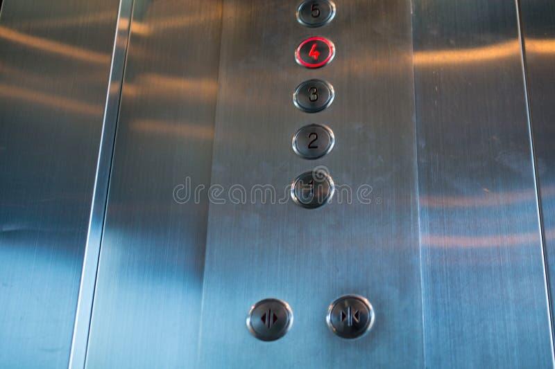 Кнопки лифта металла стоковые изображения