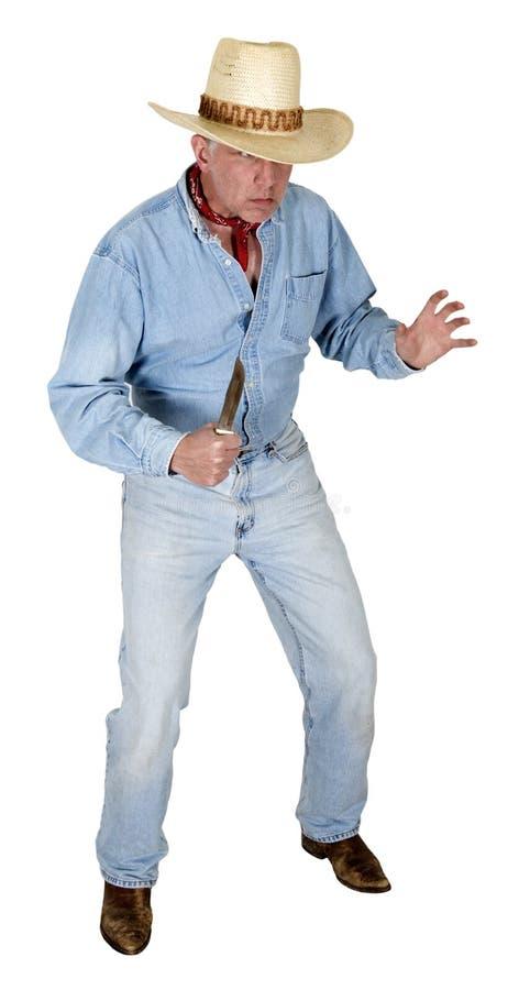 Ковбой западный, человек в западе, изолированной драке ножа стоковая фотография rf