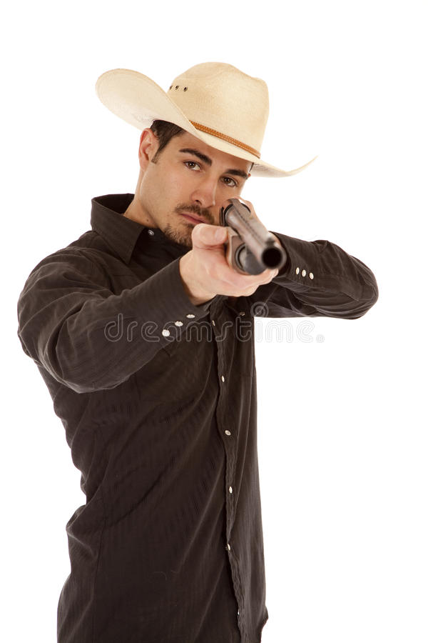 ковбой указывая корокоствольное оружие стоковое изображение