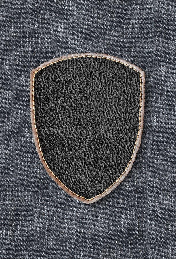Кожаная заплата на джинсовой ткани стоковое фото rf