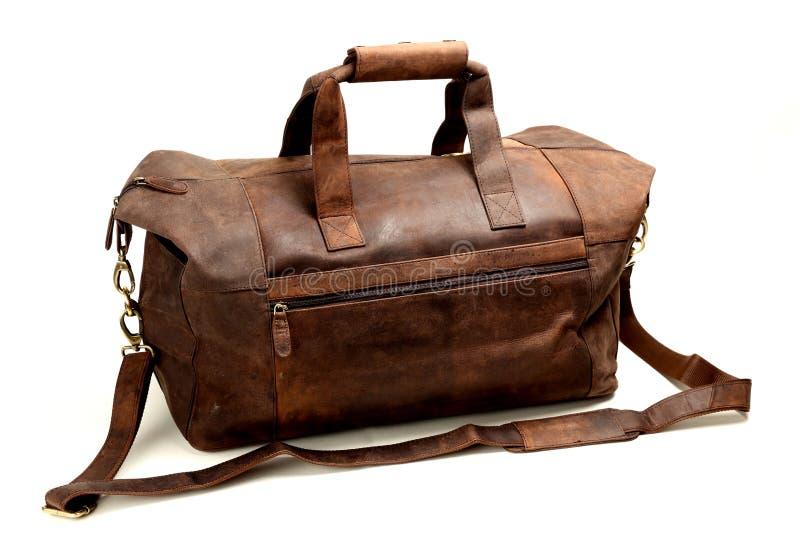 Кожаная сумка на белизне стоковая фотография