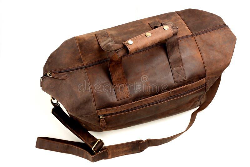 Кожаная сумка на белизне стоковые фото