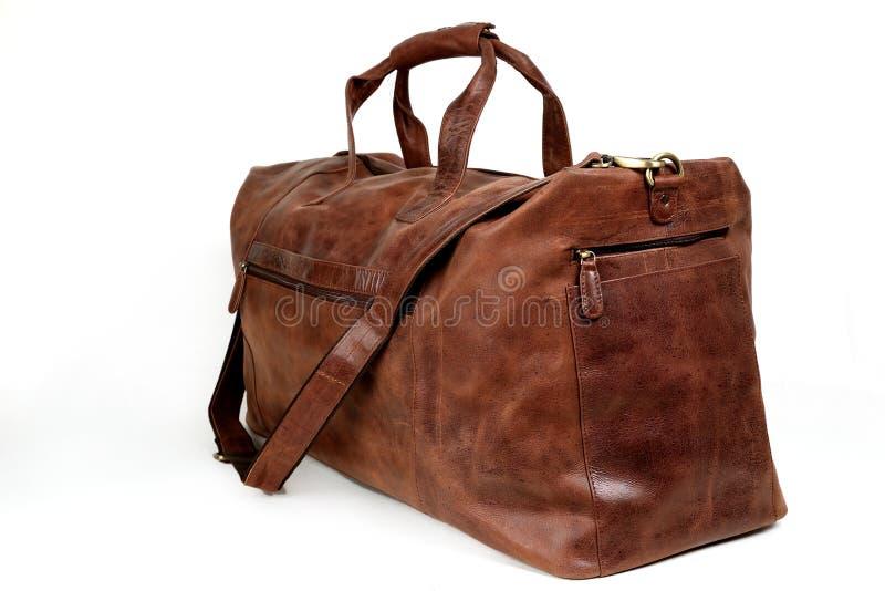 Кожаная сумка на белизне стоковые изображения rf