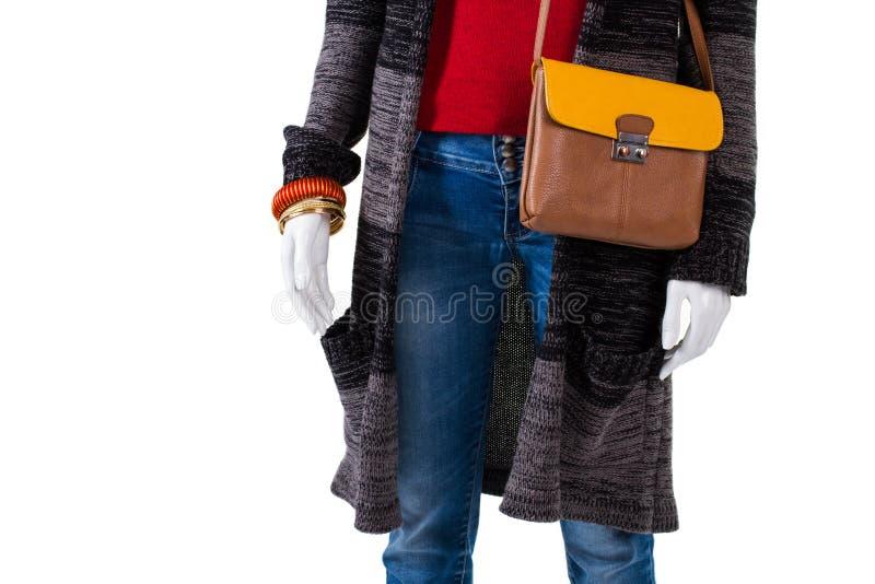 Кожаная сумка с пальто свитера стоковая фотография