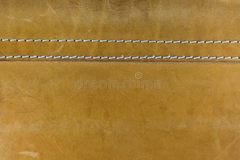 кожа шьет белый желтый цвет стоковые изображения rf