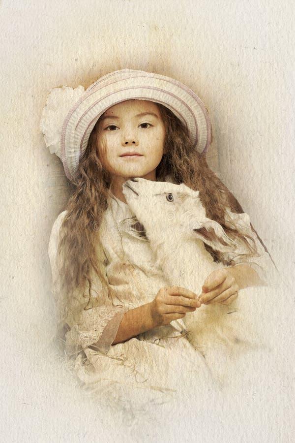 Коза маленькой девочки и любимчика стоковые фото