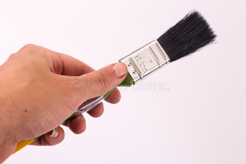 колеривщик владением руки щетки стоковые изображения