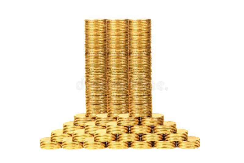Колонки монеток от желтого metal2 стоковое изображение