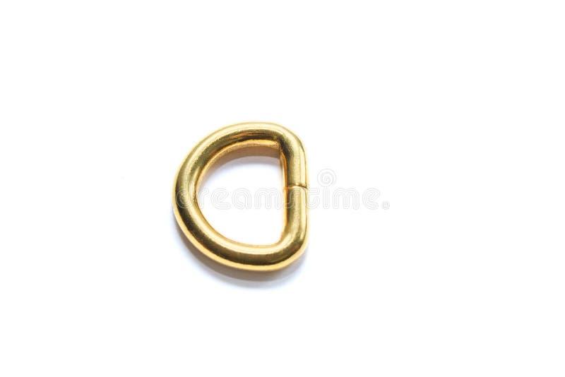 Кольцо металла половинное золотого цвета изолированное на белой предпосылке штуцеры стоковое фото