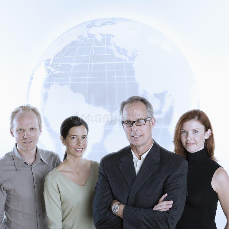 команда глобуса дела стоковое изображение