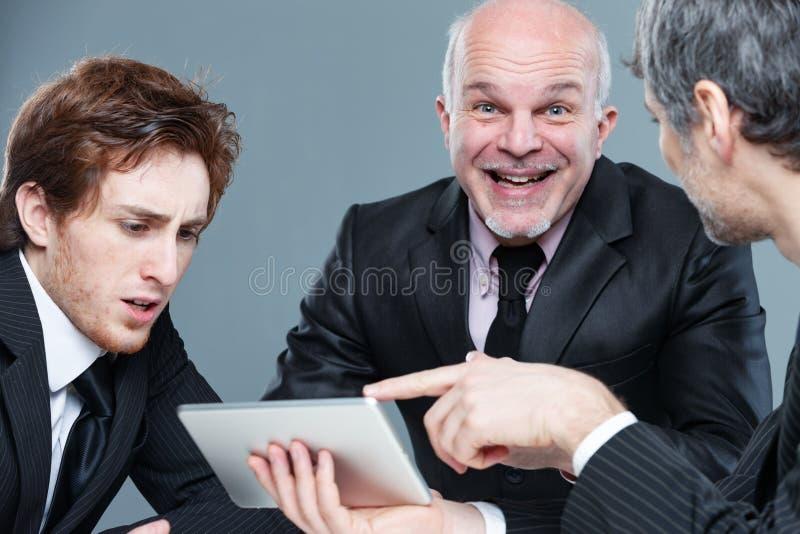 Команда дела во встрече показывая реакции стоковые изображения