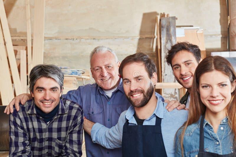 Команда успешного мастера стоковые фото