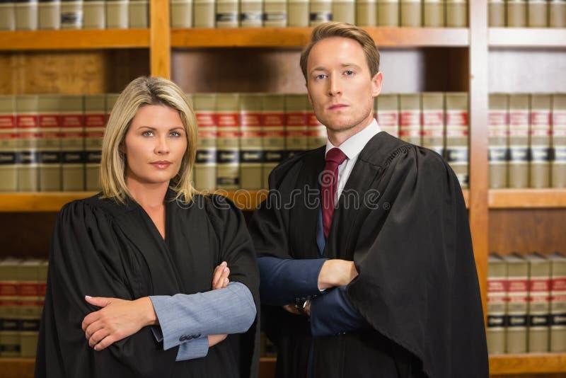 Команда юристов в библиотеке закона стоковое фото rf