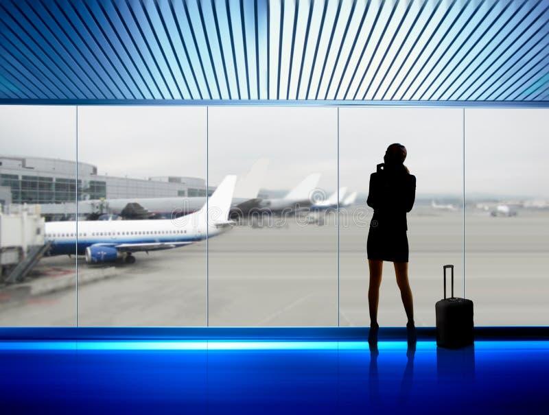 коммерсантка авиапорта стоковая фотография