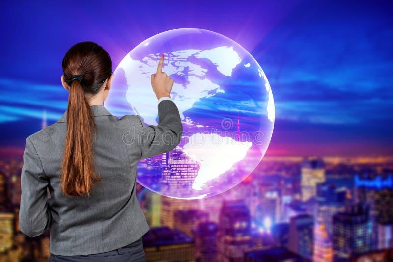Коммерсантка в концепции глобального бизнеса стоковое фото rf