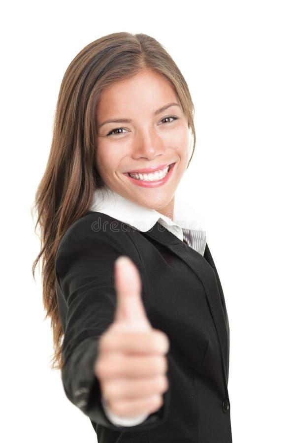 коммерсантка давая большие пальцы руки вверх стоковая фотография