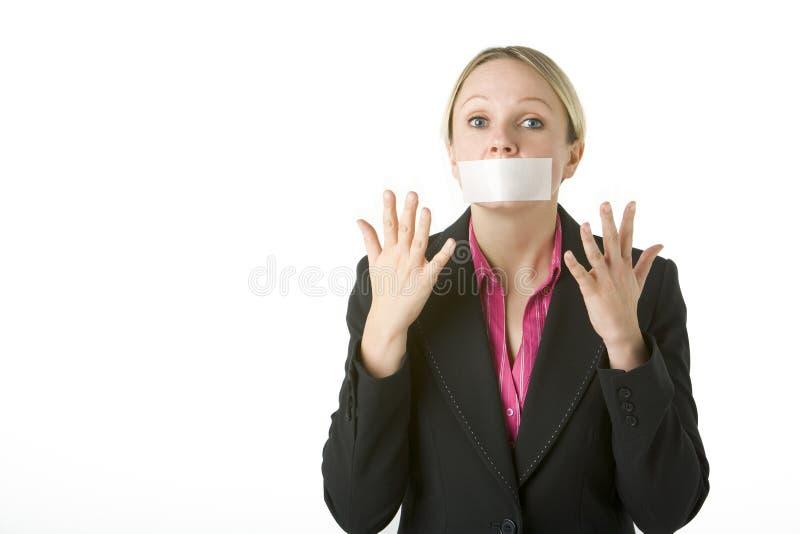 коммерсантка ее закрынный рот связанным тесьмой стоковые изображения rf